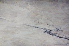 Το υπόβαθρο από τη φυσική πέτρα του ελαφριού χρώματος με τις ραβδώσεις, καλείται συγκρότημα Αγίου στοκ εικόνα με δικαίωμα ελεύθερης χρήσης