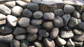 Το υπόβαθρο τοίχων πετρών στοκ φωτογραφίες