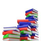 Τρεις σωροί των πολύχρωμων βιβλίων ι στο κενό άσπρο υπόβαθρο στοκ εικόνες