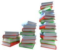 Τρεις σωροί των πολύχρωμων βιβλίων στο κενό άσπρο υπόβαθρο στοκ φωτογραφίες με δικαίωμα ελεύθερης χρήσης