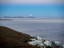 Τhe moonrise shortly after sunset with some white traditional h stock images