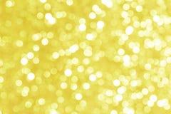 Φωτεινό χρυσό υπόβαθρο με την επίδραση bokeh για τη διαφήμιση στοκ φωτογραφία με δικαίωμα ελεύθερης χρήσης