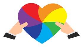 Χέρια που κρατούν μια χρωματισμένη ουράνιο τόξο καρδιά απεικόνιση αποθεμάτων