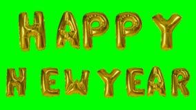 Χαιρετισμός κειμένων καλής χρονιάς λέξης από τις χρυσές επιστολές μπαλονιών ηλίου που επιπλέουν στην πράσινη οθόνη - απόθεμα βίντεο