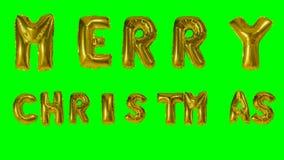 Χαρούμενα Χριστούγεννα λέξης που χαιρετά από το ήλιο τις χρυσές επιστολές μπαλονιών που επιπλέουν στην πράσινη οθόνη - απόθεμα βίντεο