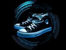 Υψηλά τοπ πάνινα παπούτσια στον μπλε κύκλο υψηλής τεχνολογίας στοκ εικόνες