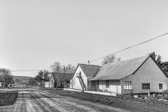 Παλαιά σπίτια με τις σοφίτες σε Sutherland μονοχρωματικός στοκ εικόνα