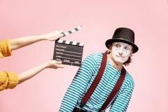 Πορτρέτο μιας παντομίματος με την κινηματογραφία clapperboard στοκ εικόνες με δικαίωμα ελεύθερης χρήσης