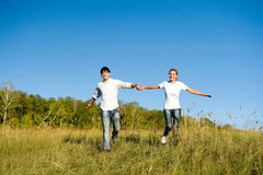 Рфззн couple running Royalty Free Stock Image