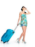 Сasual woman standing with travel suitcase Stock Photography
