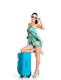 Сasual woman standing with travel suitcase Royalty Free Stock Photo