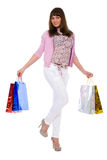 Ð¡heerful brunette with purchases costs Stock Photography
