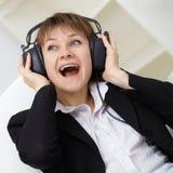 Ð¡heerful woman singing in ear-phones Royalty Free Stock Photo