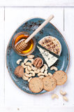 Сheese Camembert with honey and nuts. Cheese plate. Royalty Free Stock Photos