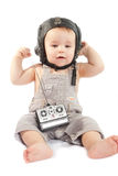 Ð¡hild in a helmet of the tankman Stock Photography