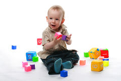 Ð¡hild plays bricks Royalty Free Stock Photo
