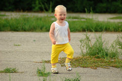 Сhild runs and smiles Stock Photography