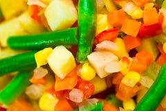 Ð¡hopped vegetables mixture. Potato, green bean, broccoli, corn, carrot, onion and sweet pepper stock image