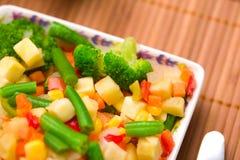 Ð¡hopped vegetables mixture. Potato, green bean, broccoli, corn, carrot, onion and sweet pepper royalty free stock photos