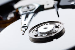 Ð¡loseup of hard disk drive. Hard drive with the cover removed and photographed with a shallow depth of field stock photo