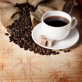 Сoffee beans and a cup Royalty Free Stock Photos