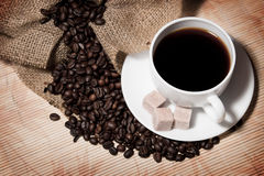 Сoffee beans and a cup Stock Photography