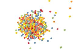 Ð¡olorful round sprinkles or sugar confetti on white background. Sugar sprinkle dots, decoration for cake and bakery. Close up royalty free stock image