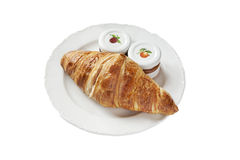 Сroissant and pots on white plate Stock Photos