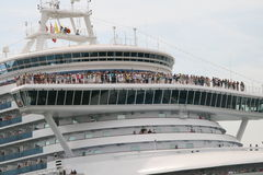 Ð¡ruise liner. A crowd of tourists standing on decks of a huge cruise liner watching the view stock photos