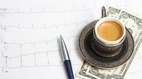 Ð¡up of coffee with 3 dollars tip Royalty Free Stock Image