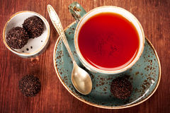 Сup of tea with chocolates Royalty Free Stock Photos