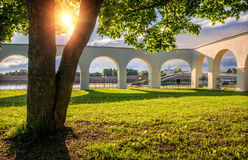 Аркада Гостиного Двора Through the arches of. Through the arches of Gostiny Dvor is the Kremlin of Veliky Novgorod in the shade of a large Royalty Free Stock Image