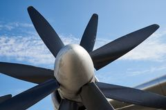 А turboprop aircraft engine with two four-bladed propellers. Against the blue sky Stock Photo