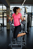 Аttractive dark skinned girl feeling so happy working out stock photos