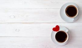 Две чашки кофе и сердечко. Royalty Free Stock Photos