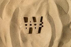 Выигранный символ под песком стоковое фото rf