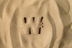 Выигранный символ под песком стоковое изображение
