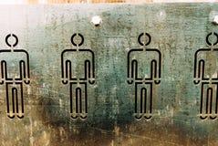 вырезанный человечек на стальном листе stock photography