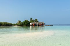 Вeautiful wooden villas, standing on stilts in the turquoise water of the Indian Ocean, Maldives. Вeautiful wooden villas, standing on stilts on tiny island in Stock Photo