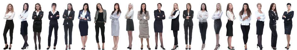 Группа в составе успешная молодая коммерсантка стоя в ряд стоковое изображение