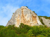 Гора. The photo was taken in Crimea in September 2013, a few kilometers from the city of Sevastopol. Mountain low, but it differs in a sharp peak. No similar Stock Images