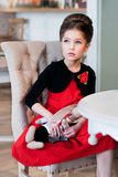Леди. Girl sitting at the table. Retro style Stock Photo