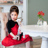 Леди. Girl sitting at the table. Retro style Royalty Free Stock Images