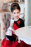 Леди. Girl sitting at the table. Retro style Royalty Free Stock Photo