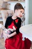 Леди. Girl sitting at the table. Retro style Royalty Free Stock Image