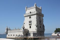 Ð•he symbol of Lisbon, the tower of Torri di Belen. The tower of Torri di Belen is a fortified structure on an island in the Tagus River in the Lisbon royalty free stock photography