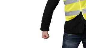 Желтые протесты жилетов Непознаваемый человек обхватил его протест кулака на изолированный Концепция революции и протеста, схватк стоковые фото
