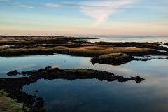Заход солнца в Straumur в Hafnarfjordur, Исландии стоковое фото