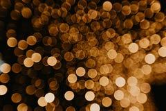 Золотое bokeh освещает запачканную предпосылку стоковые фото