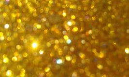 Золотой яркий блеск текстурировал предпосылку, яркий красивый сияющий золотой яркий блеск стоковое фото rf